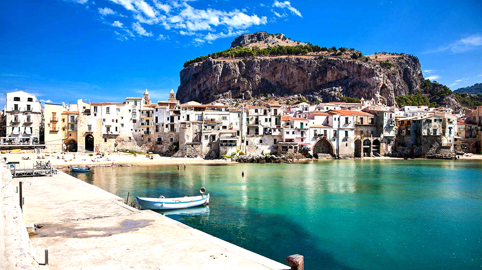 Town of Cefalù is small but popular for its sandy beaches, delicious food, movida and several thousand years of history.